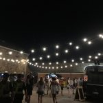 Event and festival Electricians hung up festoon lighting at the FOMO Festival