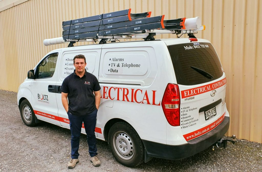 Domestic and Commercial Electricians Adelaide van with on of our electricians ready to go to a job.