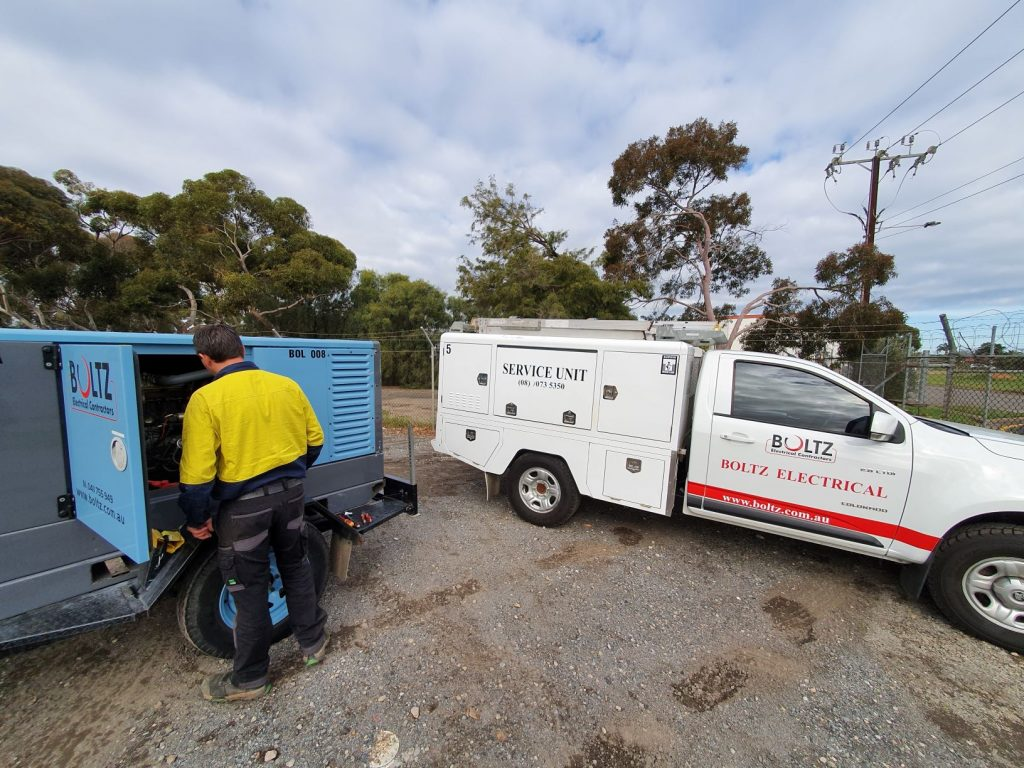Boltz Electrical van and electrician checking a generator